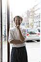 Germany, Berlin, owner and cook of a  bistro standing at entrance door - FKF001035