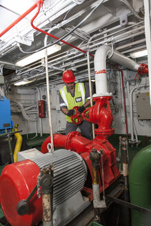 Man working in engine room on a ship - ZEF005471