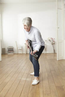 Mature woman playing electric guitar - FMKF001460