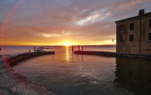 Italy, Punta san Vigilio, sunset over Lake Garda - MRF001645