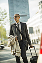 Businessman with suitcase on the go - UUF004007