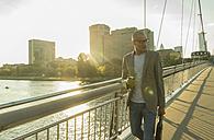 Germany, Frankfurt, businessman walking on bridge - UUF004042