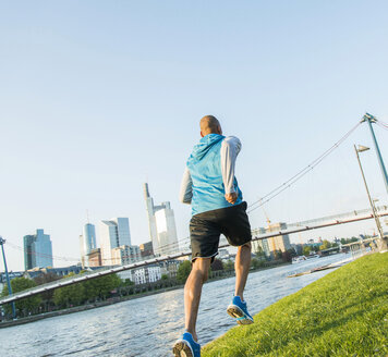 Germany, Frankfurt, man jogging by the riverside - UUF004051