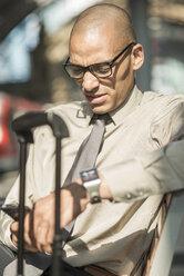 Businessman looking on smartphone - UUF004072