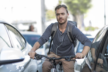 Man on bicycle in traffic jam - ZEF004609