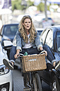 Playful woman on bicycle in traffic jam - ZEF004612