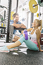 Young couple relaxing after training at gym - MADF000205