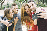 Spain, four friends taking a selfie with a smartphone - GEMF000238