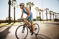 Spain, Mallorca, Sa Coma, triathlet training on bicycle - MFF001603