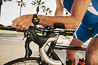Spain, Mallorca, Sa Coma, triathlet training on bicycle, close-up - MFF001608