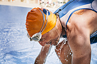 Spain, Mallorca, Sa Coma, triathlet  swimmer getting out of pool - MFF001615