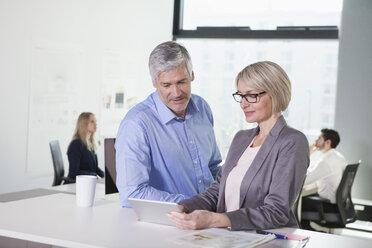 Businesspeople talking in meeting - RBF002721