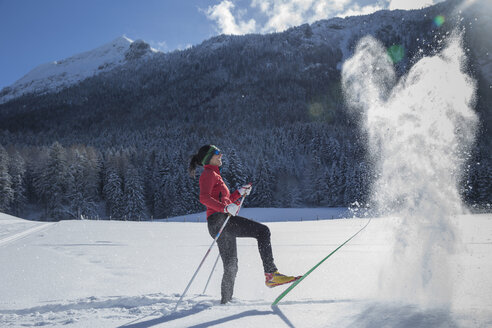 Germany, Bavaria, Inzell, female skier having fun in snow-covered landscape - FFF001435