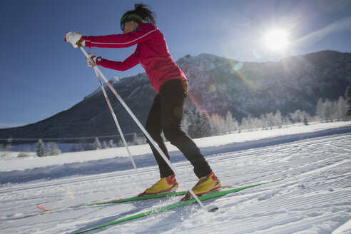 Germany, Bavaria, Inzell, female skier in snow-covered landscape - FFF001447