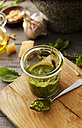 Preserving jar of homemade basil pesto - KSWF001473