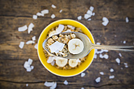 Spoon of granola, banana slice and coconut flakes - LVF003310