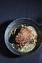 Fried fillet of beef with herb butter, peppercorns and rosemary in a pan - CSF025493