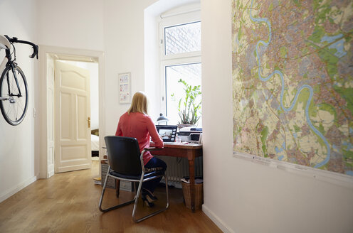 Woman using laptop at her home office - RHF000829