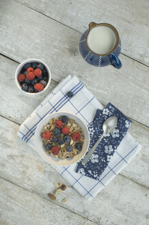 Bowl of granola with blueberries and raspberries - ASF005590
