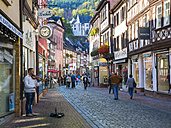 Germany, Miltenberg, view to alley of historic old town with Mildenburg in the background - AM004009
