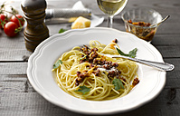 Dish of spaghetti with tomato pesto and grated parmesan - KSWF001486
