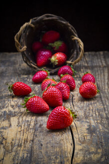 Strawberries on dark wood - LVF003357
