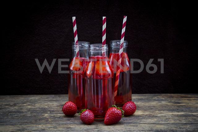 Three glass bottles of homemade strawberry lemonade - LVF003360