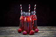 Three glass bottles of homemade strawberry lemonade - LVF003360
