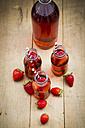 Glass bottles of homemade strawberry lemonade - LVF003365