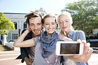 Happy friends outdoors taking a selfie - TOYF000538