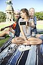 Happy friends in park taking a selfie - TOYF000543