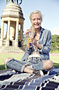 Young woman in park with soft drink - TOYF000552