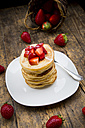 Stack of pancakes with strawberry sauce and strawberries - LVF003373