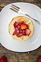 Stack of pancakes with strawberry sauce and strawberries - LVF003374