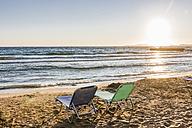 Greece, Corfu, sun loungers at Arillas beach in the evening - EGBF000053