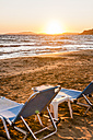 Greece, Corfu, sun loungers at Arillas beach in the evening - EGBF000060