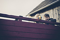 Two little boys with telescope toy - MJF001522