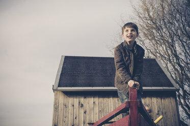 Boy playing on playground - MJF001526
