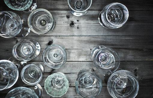 Empty wine glasses on wood - KSWF001531