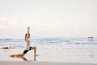 Sri Lanka, Kabalana, young woman practicing yoga on the beach - WV000744