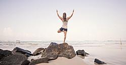 Sri Lanka, Kabalana, young woman practicing yoga on the beach - WV000751