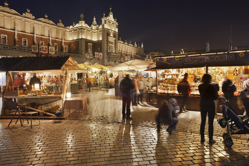 Poland, Krakow, Old Town, traditional stalls on Main Market Square at night - ABOF000021