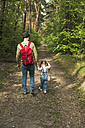 Father and daughter hiking in forest - UUF004262