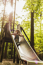Happy girl on a slide - UUF004283
