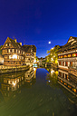 France, Alsace, Strasbourg, La Petite France, half-timbered houses, L'Ill river at night - WDF003105