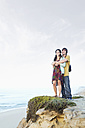 South Africa, couple standing at the coast - TOYF000630