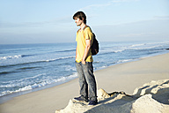 South Africa, man standing at the coast looking on the ocean - TOYF000639