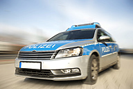 Germany, Cologne, Police car in motion - TOY000713