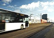 Germany, Cologbe, Bus and tram crossing bridge - TOYF000716