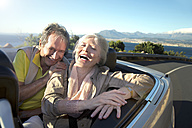 South Africa, portrait of happy senior couple sitting in a convertible - TOYF000718